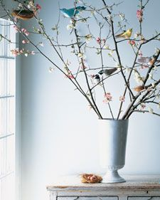 Quince branches set the stage for a scene adopted from the newly invigorated outdoors: birds perched beside nests.