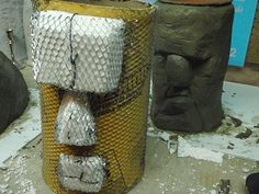 Head sculpture garden statue/planter. Bring the photo into your lumberyard to get help with a material list (from what I can tell you want a: 10 - 12' wide sona tube - get them to cut it for you if you can't fit in your car, lathe wire/mesh, scrap styrofoam, fasteners of some type, wire & quick set concrete (?) You could model them after easter island statues or...? They look like a cool project.
