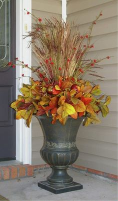 The Chic Technique: Fall front porch decorating idea of flower pot with fall greenery and straw sticks. Porch Urns, Porch Planter, Autumn Decorating, Decorating Ideas, Decor Ideas, Fall Outdoor Decorating, Fall Decor Outdoor, Fall Containers, Succulent Containers
