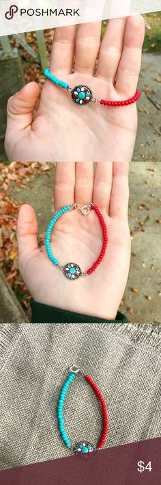 Handmade Red and Teal Bracelet High quality handmade bracelet.  Simple design with metal flower charm!  Made with sturdy 7 strand Beadalon wire and finished with spring ring clasp. Comment your wrist size after purchase for best fit! handmade Jewelry Bracelets