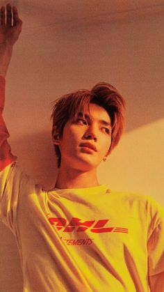 NCT's Taeyong look cute in his weird, DHL T-Shirt. I hope he was paid to wear that. Lee Taeyong, Nct 127, Capitol Records, Winwin, Jaehyun, Nct Dream, Shinee, Rapper, Photography