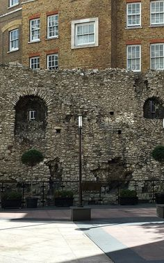 The ancient London city wall.  The base dates back to Roman times.