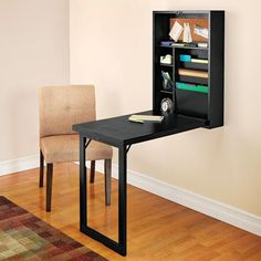 space saver  Delightful desk that folds back into a slim wall cupboard - or art work!