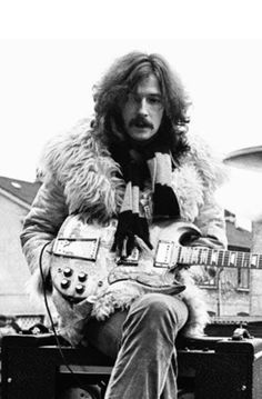 Eric Clapton... is it bad that I want this outfit?