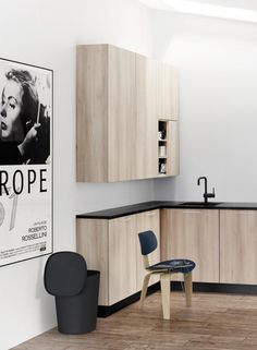 materials and colour scheme - wood kitchen and floor accented with black: note mixer...