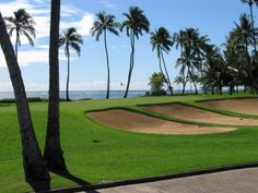 Honolulu, HI. Waialae Country Club - Championship Golf Course is home to the 2013 SONY Open. Established in 1927, the course's initial design was by Seth Raynor with changes by Desmond Muirhead in 1992. Now a mature, lushly landscaped, and player-friendly championship course, Waialae features wide forgiving fairways lined with stands of coconut, monkey pod and kiawe trees and 83 strategically place bunkers that can be in play for any golfer.