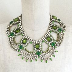 PLEASE READ THE BELOW DESCRIPTIONS CAREFULLY, YOU MAY CLICK ZOOM UNDER THE PICTURES TO SEE MORE DETAILS.  -Stunning vintage glass crystal and rhinestone necklace and pierced earrings SET in good vintage condition. -All rhinestones and crystals are intact. Main peridot/green crystals are very beautiful. -There are minor imperfections such as scuffs/scratches and dirt. -The necklace is adjustable. -Unplated metal which means you can see soldering at the back of the jewelry. This is a ...