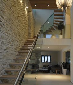 wooden cantilevered stairs with glass ballastrade  alu handrail