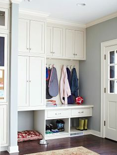 A Place for Everything This multitasking kitchen entryway leaves room for everything. With cabinets, drawers, cubbyholes, and hooks, there's no excuse for disorganization. An open area on one side of the built-in unit is the perfect spot to tuck a pet bed and feeding bowls.