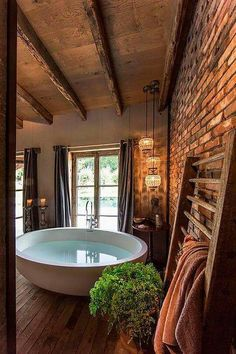 Awesome tub in a rustic bathroom.