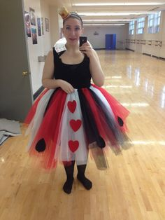 DIY queen of hearts costume. Tutu is a tie tutu. Collar is made of cards, and headband is a decorated dollar store piece. Easy and last minute!