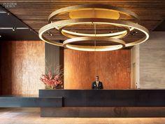 Huge circular LED pendant light over a quartz-composite counter at NYC's Abington House