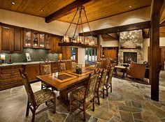 A gorgeous eat-in kitchen with flagstone flooring and all that timber, yes!!