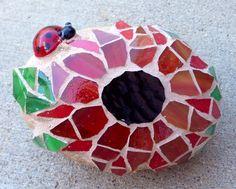 Mosaic rock with ladybug.