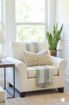 oversized white chair in the bedroom sitting area