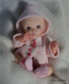 Polymer Clay. OMG how cute she is!!! Gina Holland on eBay. She sold 1/14 for $160.