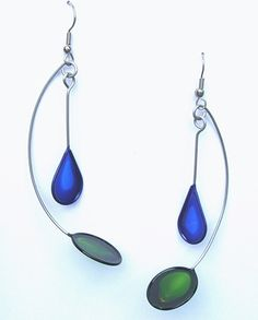 Christopher Royal Studio. Art Nouveau lines, organic curves, earrings. These featherweight earrings are made by hand-bending stainless steel and then dipping the form into a translucent, dyed resin, which creates a permanent crystal-like film. They are super lightweight jewelry and yet quite durable. The ear wires on these earrings are surgical steel.