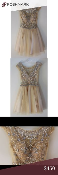 Jovani Cream Beaded and Tool Dress Cream Cool with gold and silver gems all on the upper half Jovani Dresses Prom