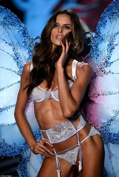 Preened to perfection:Izabel Goulart wowed in the tiniest of knickers and suspenders, as she held her hair to her face in a flirty manner
