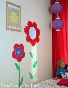 Simple flower mural with a sunshine printable for little girls room.
