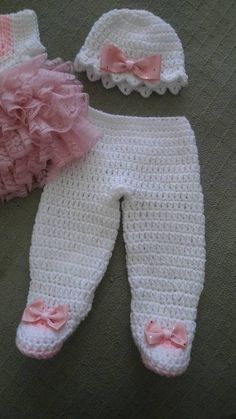 white crochet baby dress with pink lace ruffles pants with
