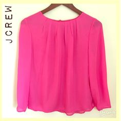 Hot Pink Silk Blouse Think Spring in this flowing pink silk top from J Crew. In EUC- like new! Button closure and keyhole feature in back. Button closures on each cuff. Outer layer 100% silk. Fully lined. This is a beauty! J. Crew Tops Blouses