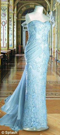 The Princess of Wales wore this pale blue and lace evening dress with demi train and two trailing ties on an official visit to Nigeria in 1990. Designed by Catherine Walker, this gown raised $ 36,800 for Diana's charities at the Christie's auction in New York.