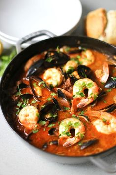 "SUMMER SEAFOOD STEW ~~~ she labels the flavor profile of this stew as that between a bouillabaisse and cioppino. ""caramelized fennel adds a subtle sweetness, fresh tomatoes add a good tanginess, while spanish chorizo kicks up the flavor by adding the perfect amount of heat and heartiness"". in her share, she chooses to go for soy chorizo, but my preference was real deal spanish chorizo (next time around i am thinking that mexican chorizo might be a cool riff to apply). [feastingathome]"