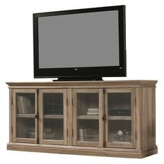 "Display up to an 80"" television with this stylish stand, featuring adjustable interior shelves and an enclosed back panel for cord access. Safety glass-paned doors are perfect for displaying your DVD library, and won't interfere with remote access."