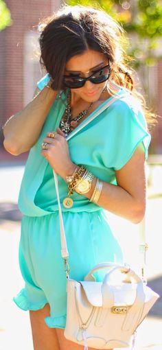 Aqua romper, bangles and white purse