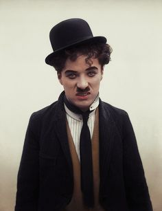 A colored pic of Charlie Chaplin as The Tramp.