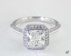 SKU 49755 - An awe inspiring octagonal halo sets atop a knife edge pave shank and center milgrain edge detailing.  A spectacular display of beauty! *Please allow additional time for fancy shape diamonds and gemstones.*