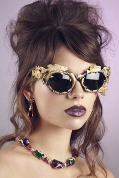 Takes a lot of moxie to wear these incredible glasses! But I love the lip color!