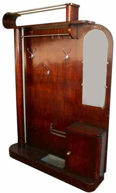 1930s French Art Deco walnut Hallstand. It features all chrome hardware and caters for umbrella, coats, hats and comes complete with small cupboard and half length mirror. (hva)