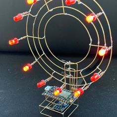 Circuit sculpture using a Particle Photon and 3 BJTs to switch a ring of red LEDs Electronic Circuit Projects, Electronic Engineering, Electronic Art, Electronics Components, Diy Electronics, Electronics Projects, Led Projects, Arduino Projects, Projects To Try