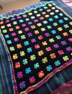 Rainbow and black Granny Square Crochet Blanket by MerryPeridot, £40.00