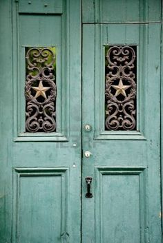 Old green wooden door in the French Quarter, New Orleans LA, reminds me of our diningroom table!