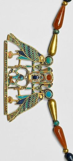 Pectoral and Necklace of Sithathoryunet with the Name of Senwosret II, Middle Kingdom. 12th Dynasty during the reign of Senwosret II, from Egypt, Fayum Entrance Area, el-Lahun (Illahun, Kahun; Ptolemais Hormos), Tomb of Sithathoryunet (BSA Tomb 8), EES 1914. Gold, carnelian, lapis lazuli, turquoise, garnet (pectoral) Gold, carnelian, lapis lazuli, turquoise feldspar.