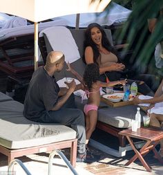 Family time: North entertained her parents as they ate lunch by the pool