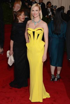 January Jones in Versace - I loved the color on the red carpet last night.. January Jones in this canary yellow versace with a pop of turquoise on her neck was perfection for me.