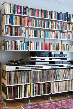 A faithful shelving system bearing its load of books, vinyl and audio equipment. Notice the semi-wall mounted structure with stabilising feet for the heavy load vitsoe Record Shelf, Vinyl Record Storage, Storage Shelves, Shelving, Wall Shelves, Deep Shelves, Glass Shelves, Lp Regal, Vinyl Room