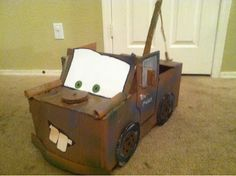 Cars characters costumes out of cardboard boxes. - Mater