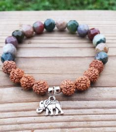 Check out this item in my Etsy shop https://www.etsy.com/uk/listing/247068996/lucky-elephant-charl-rudraksha-woodland