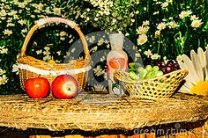 Still life, fruit basket, red apples, a vase of flowers, wicker basket with…
