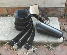 Ring Belt    $45.00    Pirate or captain, guild brewer or bread maker, the ring belt was a common belt worn by both men and women. They carried pouches, favors, mugs and whatnots. Ours are handmade and dyed so your garments won't ever have black dye come off on them. Made of 8-ounce leather, approximately 50-60 inches long by 1 3/4 inches wide.