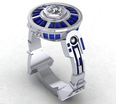 That's one classy R2D2 engagement ring! ~ Hey, at least, they are Sapphires, my favourite stone ( besides lapis )