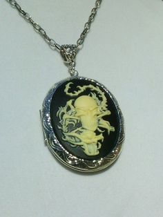 Check out this item in my Etsy shop https://www.etsy.com/listing/248780233/dragon-and-skull-and-crossbones-cameo