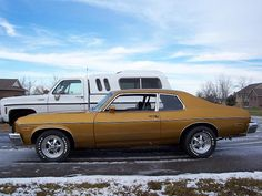 '74 Chevy Nova The first car I owned was one of these.  I loved that car. Mine was medium canyon red metallic.  Had it from 1987 to 1992!