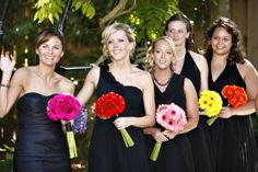 Bridesmaids with assorted bright Canadian gerberas