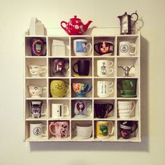 My coffee mug / tea cup shelf! A place for my collection <3 Also a place to display my crazy without looking too crazy. (Note the Grinch, Nightmare Before Christmas, Alice in Wonderland, Disney...)